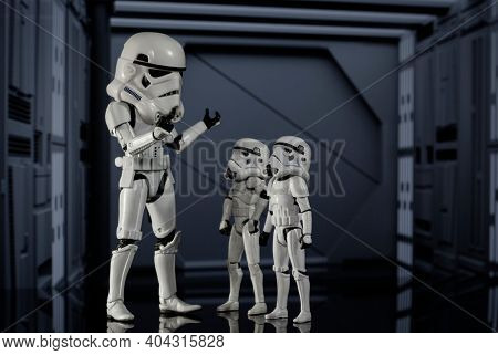 JAN 20 2021: humorous Star Wars concept of adult and child Stormtroopers with oversized helmets - Hasbro action figure