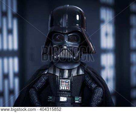 JAN 20 2021: humorous concept of a big head Darth Vader Star Wars humor - Hasbro action figure