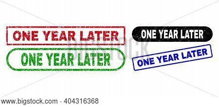 One Year Later Grunge Stamps. Flat Vector Grunge Stamps With One Year Later Text Inside Different Re