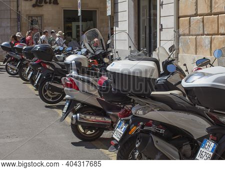 Lecce, Italy April 4, 2018 Parking Of Light Two-wheeled Motorcycle, City Transport.