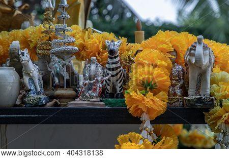 Thai Dancing Dolls, Zebra Doll And Marigold Flower Garlands In The Thao Maha Phrom Shrineis. Selecti