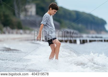 Boy On The Beach. Family Vacation By The Sea. Active Lifestyle