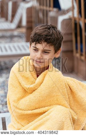 Boy On The Beach Wrapped In A Bath Towel. Family Vacation By The Sea. Active Lifestyle