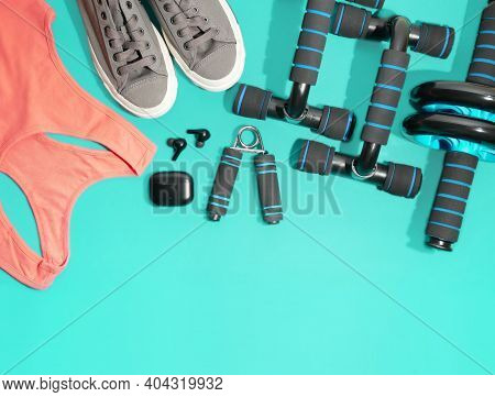 Flat Lay Of Sport And Fitness Equipment On Green Background With Copy Space. Pantone Stay Home Train