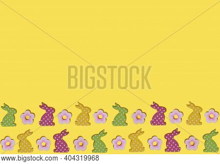 Easter Border, Colorful Rabbits On Yellow Background With Copy Space. Flat Lay Composition With Deco