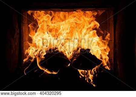Burning Cozy Fire. Glowing Fireplace Logs. Coziness Warm Christmas Time