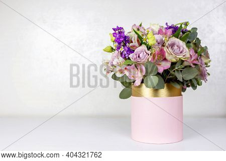 Beautiful Bouquet Of Flowers In Pink Round Box On A White Table. Gift For Holiday, Birthday, Wedding