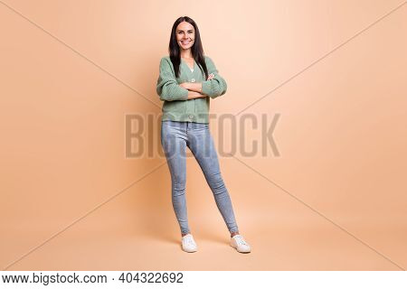 Full Length Photo Of Nice Happy Beautiful Woman Crossed Arms Charming Smile Isolated On Pastel Beige