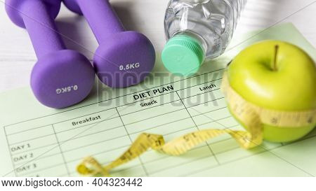 Close Up Dumbbells With Measuring Tape .  Diet Health Plan.  Nutrition Start Up Workout Planing. Spo