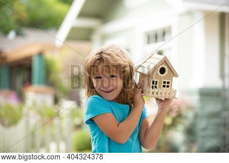 House In Kids Hands. Family Home, Home Protecting Insurance Concept, Child Boy Building House, Home