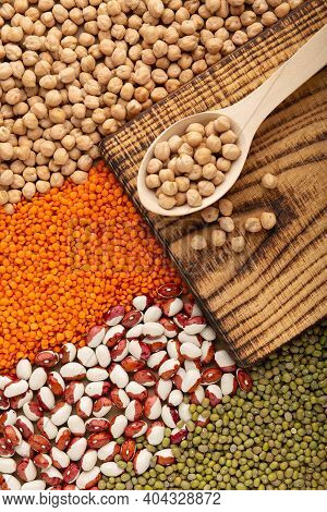 Chickpea Seed On Wooden Spoon With Various Of Legumes Top View