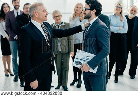 Manager Congratulating The Best Employee At The Meeting