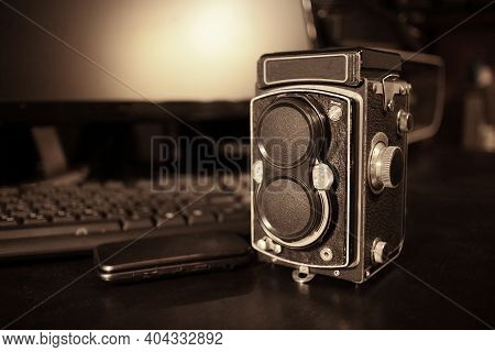 The Old Medium-format Tlr Camera On Table With Noise And Film Grain.