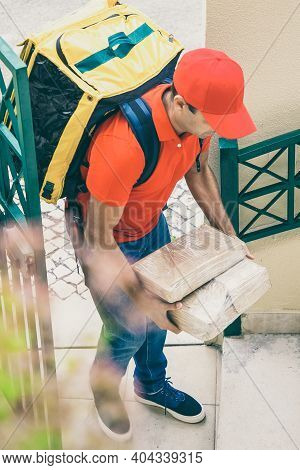 Professional Courier Delivering Order At Home And Working In Express Service. Caucasian Deliveryman
