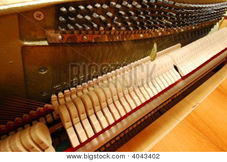 Shoot of the inside of an old piano with