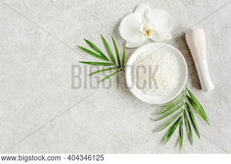 Spa Skincare Concept. Natural Organic Spa Cosmetics Products, Sea Salt And Tropic Palm Leaves On Gra