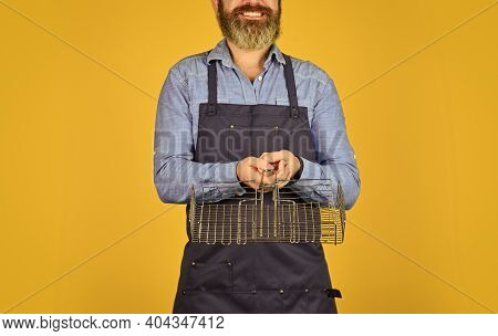 Cooking Healthy. Man In Apron Hold Barbecue Grill. Culinary Concept. Tools For Roasting Meat. Cookin