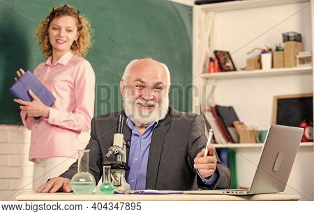Study Biology. Biological Research. Teacher And Girl With Notepad Near Chalkboard. College Universit