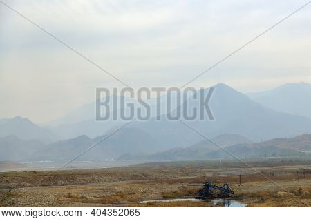 North Korea Landscape. South Pyongan Province. Mountains And Shore Of The Taedong River At Dawn
