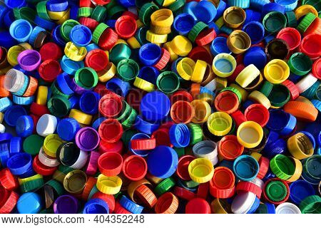 Plastic Bottle Caps Background. Cap Material Is Recyclable.remove Lids From Plastic Bottles Before R