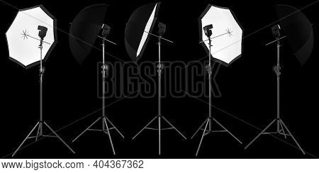 Photography Studio Lighting Stand With Speedlight And Umbrella Isolated On Black