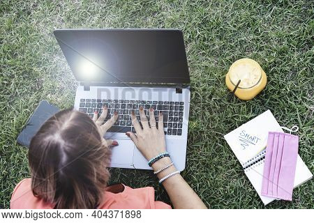Woman 40 Years Old Working Outdoors With Laptop While Making Healthy Breakfast - Female Entrepreneur