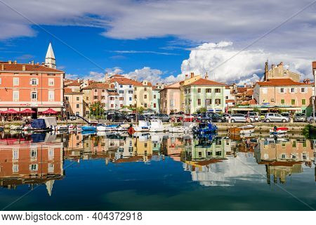 Izola, Slovenia - September 20, 2016: The Scenic Harbor With Boats And Brightly Coloured Houses On T