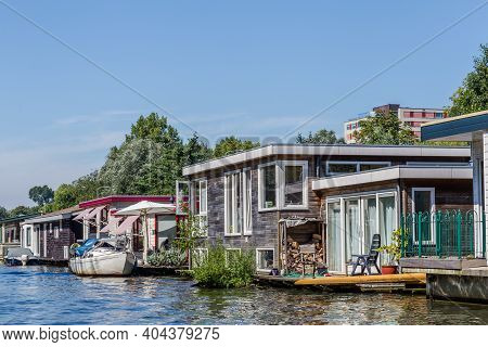 Floating Houses Near Utrecht In The River Vecht In The Netherlands. Holalnd Has A Long Tradition Of