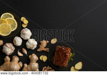 Ginger And Other Natural Cold Remedies On Black Table, Flat Lay. Space For Text