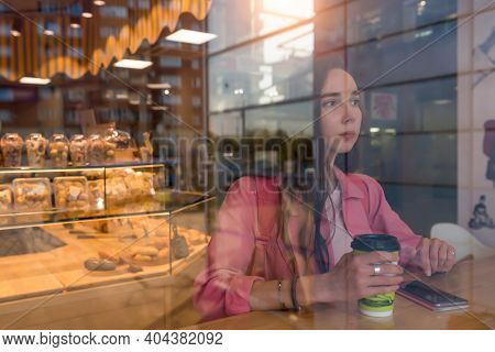 Woman In Summer In A City Cafe. Free Space For A Copy Of Text. Background Of Coffee Tea Pastries And