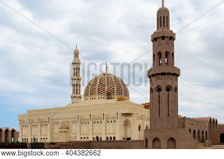 Sultan Qaboos Grand Mosque In Muscat, Oman, Exterior View With Majestic Dome And Minaret.