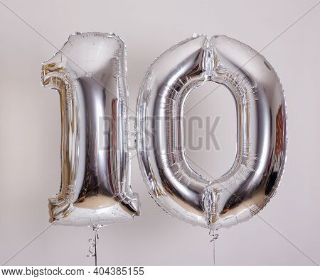 Birthday Or Anniversary Concept - Foil Number 10 Air Balloons Over White Background