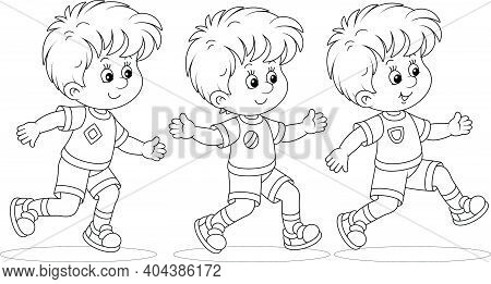 Cheerful Little Boys Running A Race At An Athletics Competition On A Sports Ground, Black And White