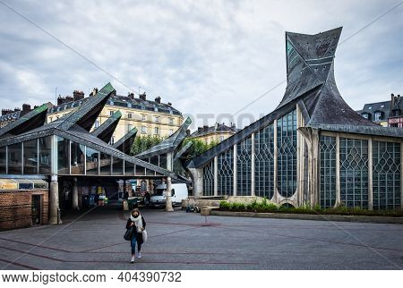 Rouen, France, Oct 2020, View Of A Woman Crossing The Vieux-marché Square With The Joan Of Arc Churc