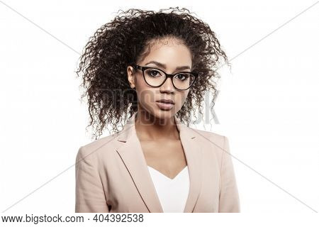 Businesswoman. African American Woman in business or teacher on a white background. Girl in a strict suit and glasses.
