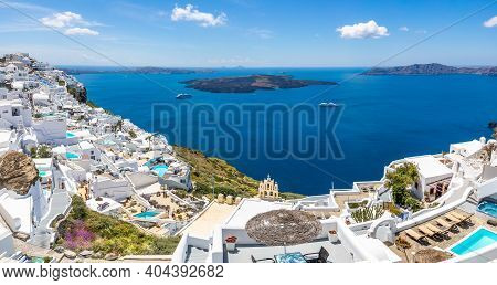 White Wash Staircases On Santorini Island, Greece. The View Toward Caldera Sea With Cruise Ship Awai
