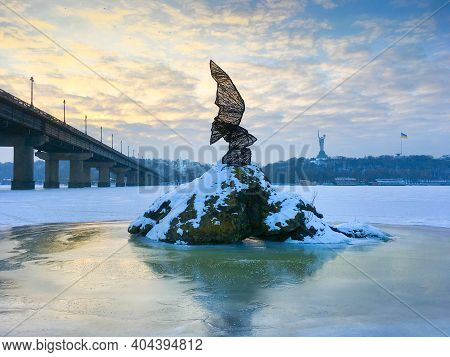 Kiev, Ukraine - January 20, 2021: Monument To A Rare Bird In The Middle Of Frozeb Dnieper River In T