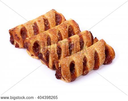 Group of puff pastries (puffs) cakes with jam isolated on white background