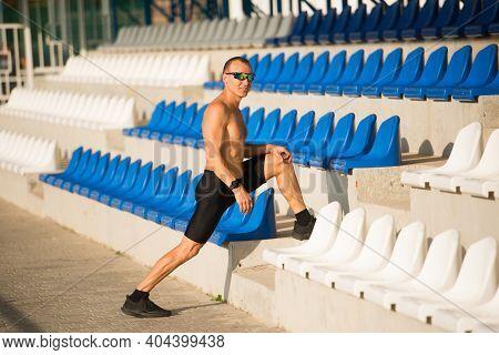 Athlete Runner Warming Up At The Stadium