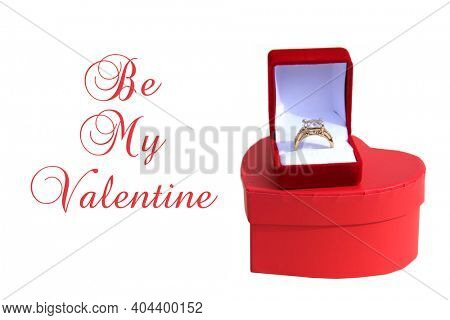 Valentines Day. Wedding Ring with a Red Valentines Day Heart. Engagement Ring in a Red Ring Box with a Red Heart. Isolated on white. Room for text. Happy Valentines Day. Be My Valentine.