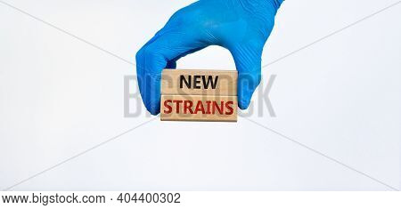 Covid-19 New Strains Symbol. Hand In Blue Glove Holds Wooden Blocks, Words 'new Strains'. Beautiful