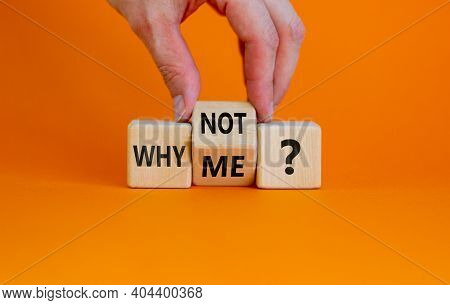 Why Not Me Symbol. Businessman Turns A Cube And Changes Words Why Me To Why Not. Beautiful Orange Ba
