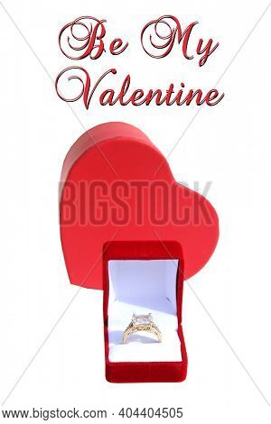 Valentines Day. Wedding Ring with a Red Valentines Day Heart. Engagement Ring in a Red Ring Box with a Red Heart. Isolated on white. Room for text. Happy Valentines Day. Be My Valentine