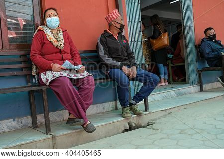Kathmandu, Nepal, 17 March 2020: People Wearing Protecting Masks Outside A Hospital, Waiting For Che