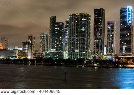 Miami Florida At Sunset, Skyline Of Illuminated Buildings And Macarthur Causeway Bridge. Miami Night