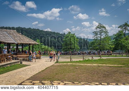 Plitvicka Jezera, Croatia, July 2019 Tourists In Wooden Restaurant And Queuing For Ferry In Plitvice