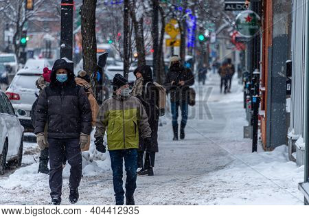 Montreal, Ca - 21 January 2021: Pedestrians With Face Masks For Protection From Covid-19 Walking Dow