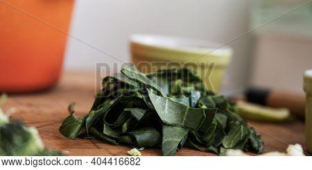 Closeup View Of Cut Fresh Green Mangold On Wooden Cutting Board.