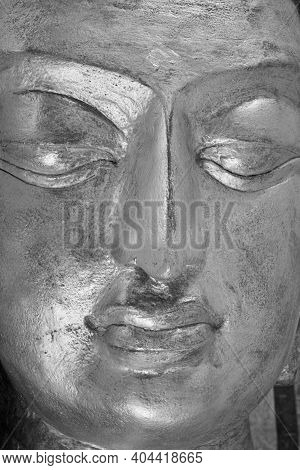 Phayao, Thailand - Dec 6, 2020: Portrait Black And White Close Up Face Of Gold Buddha Statue With Na