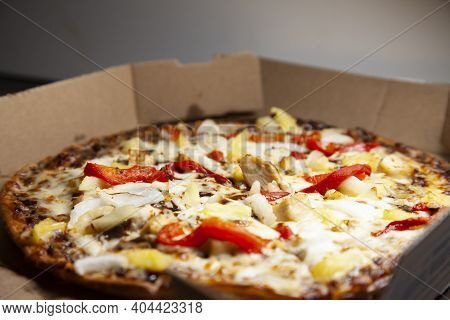 Barbeque Chicken, Red Bell Pepper, Onion, Pineapple Pizza In Its Carryout Box